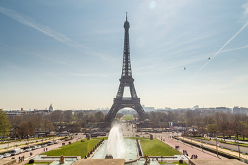 Eiffel Tower and fountain at Jardins du Trocadero at sunrise in Paris, France. Travel background