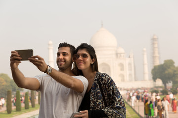 Couple taking selfie photo in Taj Mahal, India