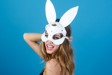 Beauty glamor woman celebrating Christmas, New Year in rabbit mask. Attractive woman in sexy lingerie and in bunny mask. Sexy blonde girl wiht white bunny ears.