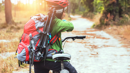 Photograph Asian women travel  Nature. Travel relax ride a mountain bike Wilderness in the wild. Thailand
