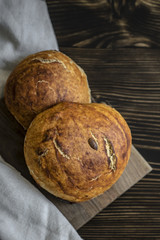 Freshly baked bread on dark  kitchen table