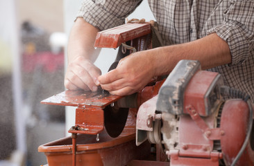 sawing, cutting stone, searching for agate