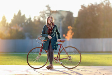 Hipster girl with vintage bicycle