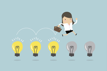 Businesswoman jump on light bulbs. vector