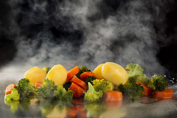 Steamed vegetables on tray.