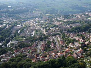 panoramic aerial view of the town of halifax in west yorkshire with roads streets houses and surrounding pennine landscape