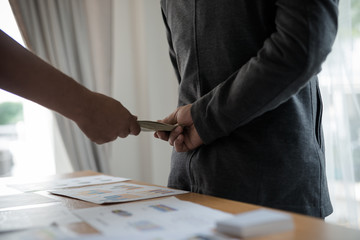 Men's hands, sending money to business travelers. Corruption and bribery concept
