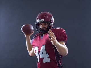 american football player throwing ball
