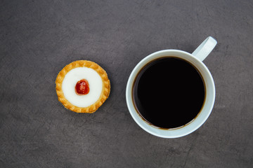 Cherry bakewell tart cake and coffee cup