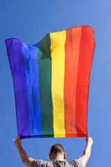 young man with a rainbow flag
