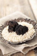 Black truffles and white rice.