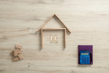 Residential house for a family next to a calculator and notebook