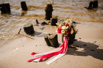 Bridal bouquet near the water