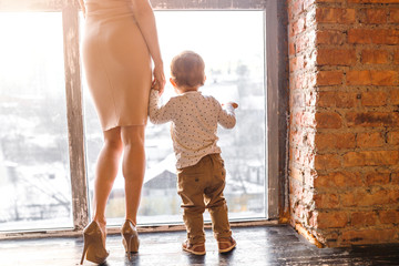 Mother and son together near big window