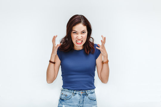 A very frustrated and angry hatred woman isolated on white background in studio