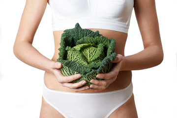 Close Up Of Woman In Underwear Holding Cabbage