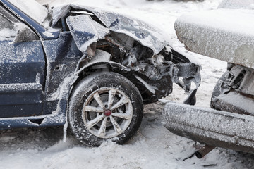 Crashed cars in accident on winter road