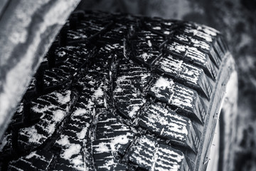 Snow tire with metal studs, car wheel