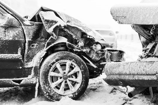 Car accident on winter road, black and white