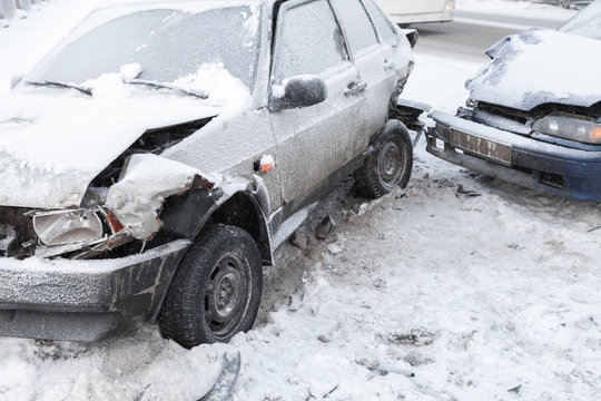 Two crashed cars in accident on winter road