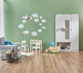 decorative baby room modern furnitures and pattern with white lamp.