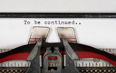 Macro detail of To be continued on electric typewriter with ribbon