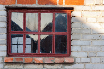 Wall texture with white bricks and inserted old window