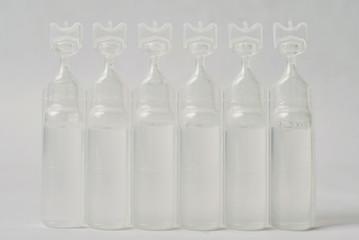 Plastic bottle of serum saline.