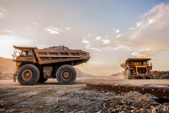 Mining dump trucks transporting Platinum ore for processing