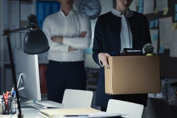 Boss firing an employee in the office