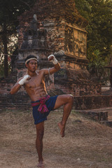 Ancient Muay Thai, Asian man exercising thai boxing,Ancient traditional Muay Thai or Thai boxing fighter putting bandage old style  at Thailand.