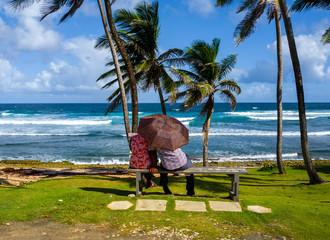 Older couple watching the ocean