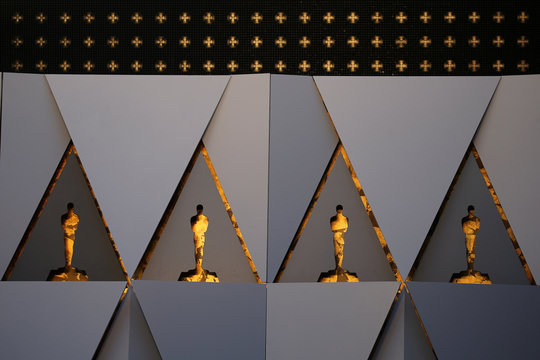 Gold painted Oscar cutouts are constructed as a background for arriving guests and nominees in preparations for the 90th Academy Awards in Hollywood, Los Angeles