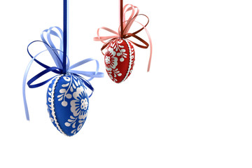 Colorful Easter eggs stock images. Decorated eggs on a white background. Spring decoration images. Hanging Easter eggs. Blue and red easter eggs