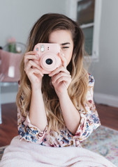 Teenage girl taking pictures with camera