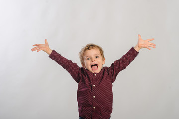 young happy Little boy on gray background