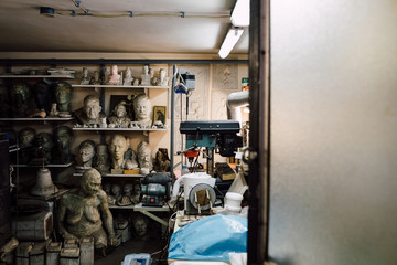 Workshop full of busts made out of clay