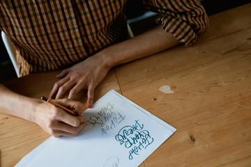 Hand lettering practice in studio