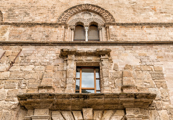 Wall with Mullioned windows with lava stone inlays of the Palace Steri Chiaramonte, Palermo, Sicily, southern Italy