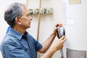 Man checking water heater at vacational rental