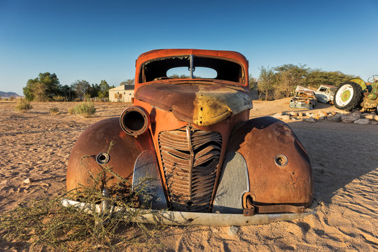 Old and abandoned car in the desert of Namibia. Solitaire. With the beautiful light of the sunrise.