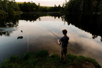 teen fishing at sunset