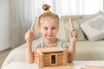 cute little girl with house model