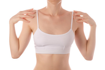 Young beautiful woman in white t-shirt top bra hands on shoulders beauty health sports exercise