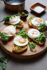 Avocado and fried quail egg toasts.