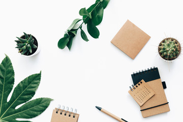 Flat lay minimalistic green and brown styled home office desk. .