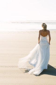 Beautiful Bride Walking towards the Pacific Ocean
