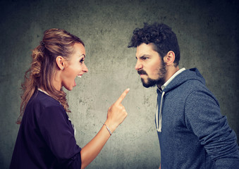 quarrel between angry man and frustrated woman
