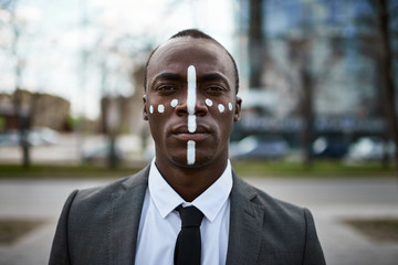 Businessman with painted face