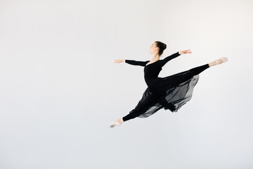 Young woman jumping while dancing